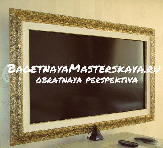 Телевизор на стене в рамке